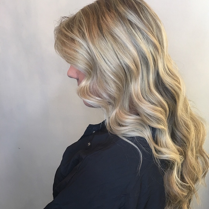 highlights Brixton with a wavy blowdry on long hair in salon in London