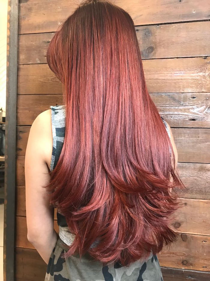 Red shiny hair balayage at Clapham hair salon