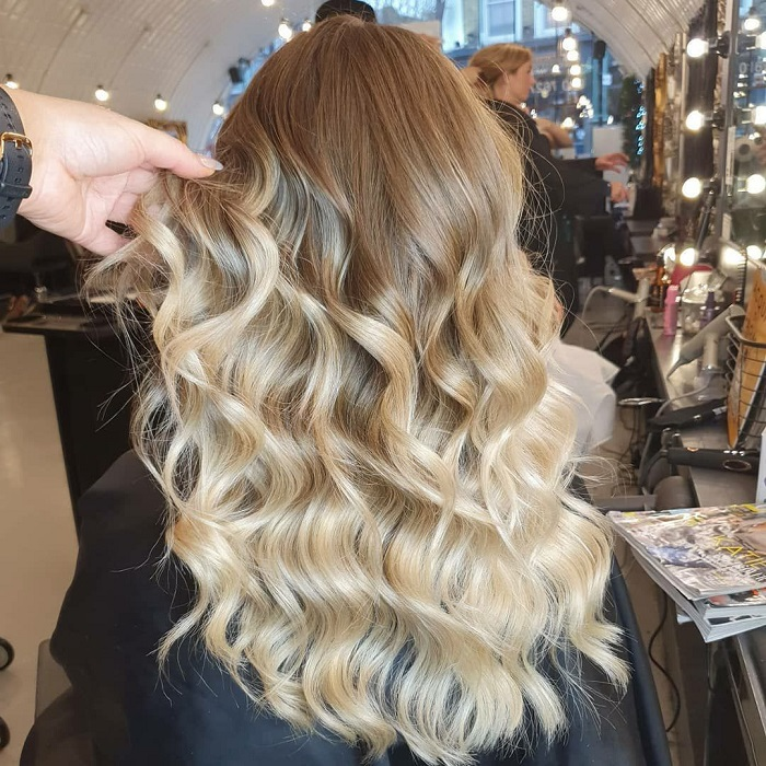 curly hair styled with waves at live true london